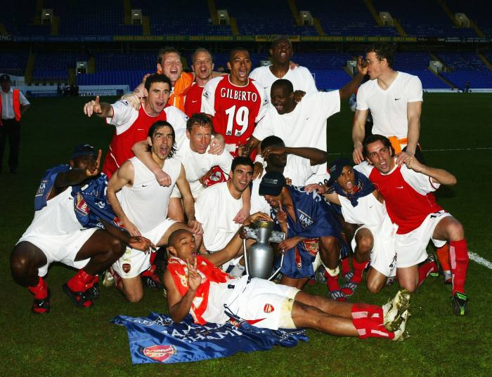 Winning the league at the home of north London rivals Tottenham, April 2004. Arsenal finished the league season unbeaten, the first team to do so since Preston North End in 1889