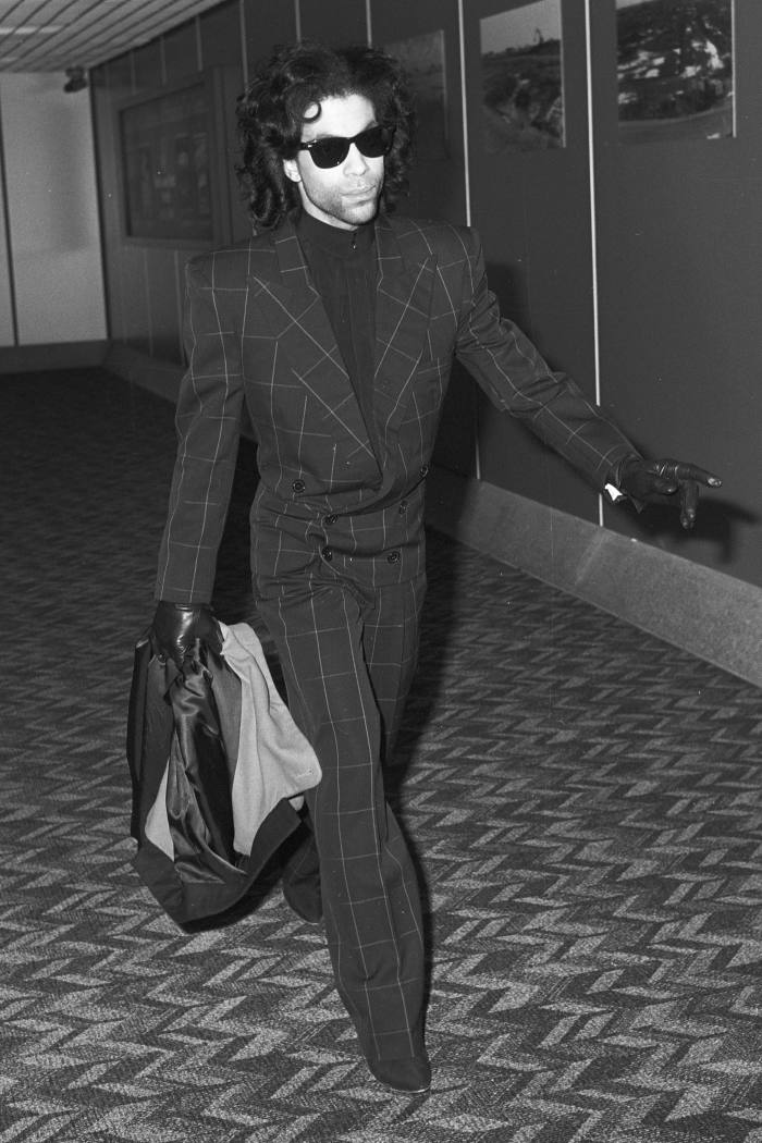 Prince in his windowpane suit at London Heathrow, 1989