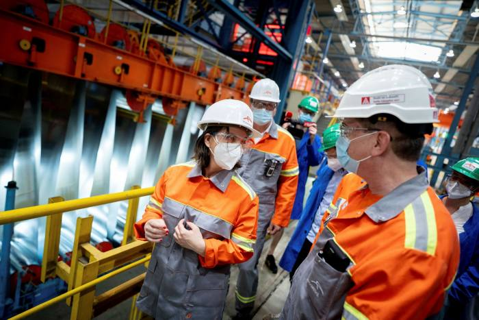 Annalena Baerbock, the Green party's candidate for chancellor, talks to employees during a visit to an ArcelorMittal steel plant