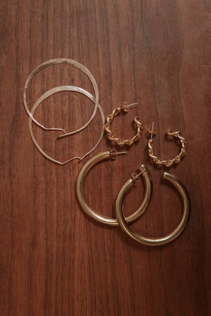 Gold hoop earrings are her style signifier