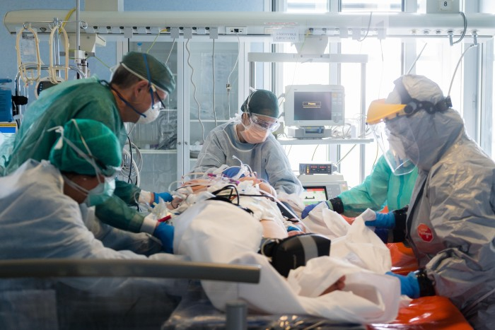 Nurses prepare a patient for transport at Cremona Hospital on March 29 in Lombardy. The experience of northern Italy in late March caused many scientists to sharply revise up their predictions of likely deaths