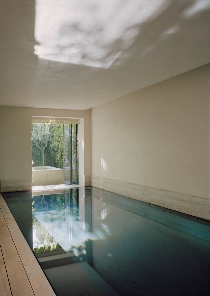 The basement pool continues the contemporary, light-filled aesthetic