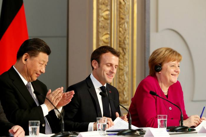 Chinese president Xi Jinping with French president Emmanuel Macron and Angela Merkel. France, Germany and the UK have recently criticised China over human rights