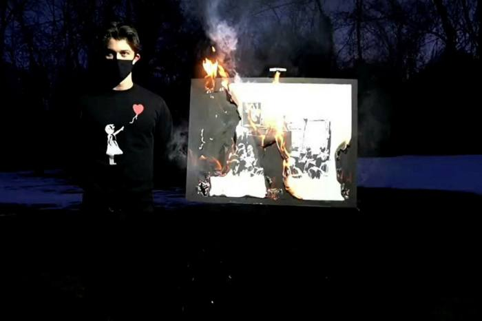 Burn after viewing: Banksy's 'Morons' is destroyed