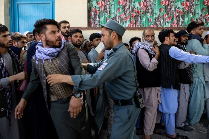 Afghans forming lengthy queues at a passport office in Kabul on August 14, as the Taliban close in on the capital after taking Herat, Mazar-i-Sharif and the country's second-largest city, Kandahar