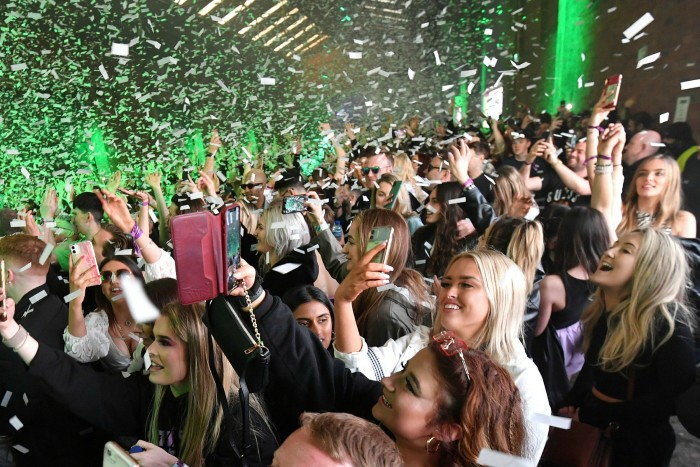 A government-run live event in Liverpool in April to test safety of mass gatherings. The end of compulsory mask wearing in crowded indoor spaces and on public transport on July 19 has attracted the strongest criticism