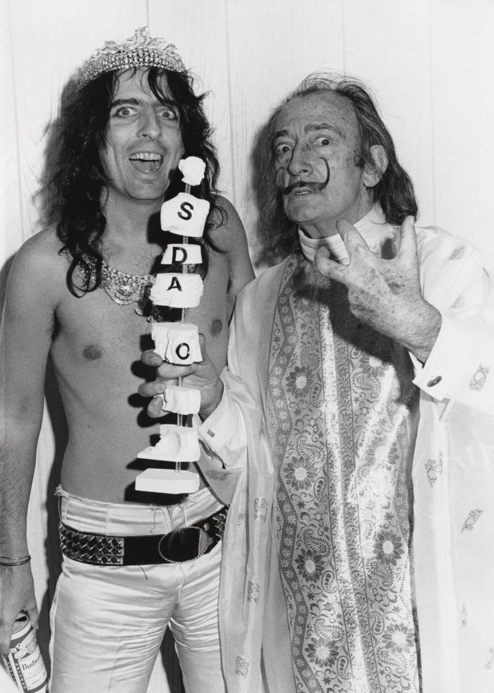 In 1973 with Salvador Dalí, who created a sculpture of Cooper's brain made out of éclairs and ants. Below right