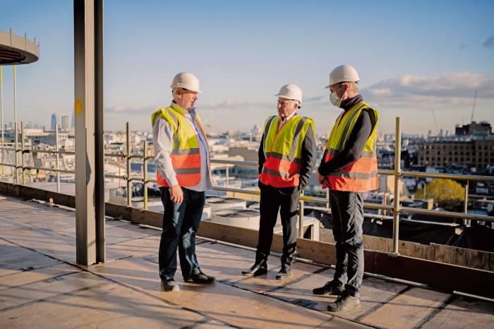 McKillen (centre) on the roof of Claridge's with construction director Norman McKibbin and Mark Allen, director of quantity surveyors Rainey & Best