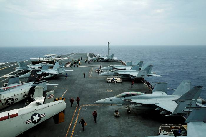 F/A-18 Hornet fighter jets and E-2D Hawkeye plane on the US aircraft carrier John C Stennis during the Malabar military exercise, with the US, Japan and India participating, in June 2016