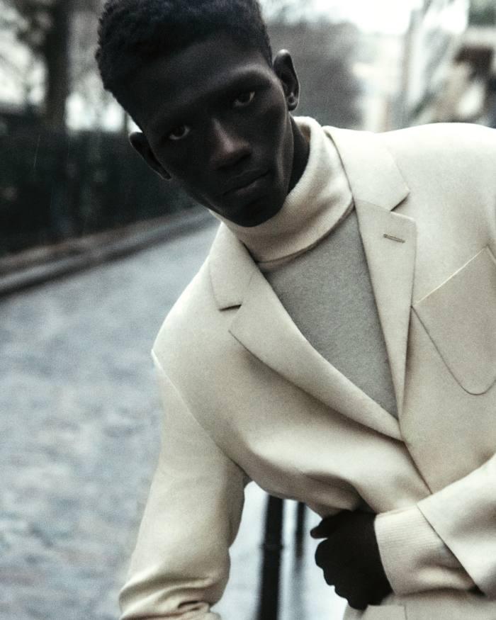 Moustapha wears Paul Smith linen blazer, £570. Louis Vuitton cashmere rollneck sweater, £915