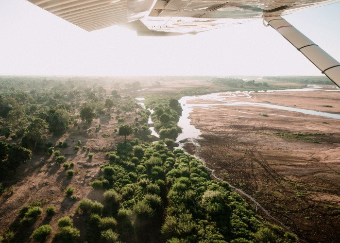 Flying over the Gonarezhou National Park in southeastern Zimbabwe: the country anticipates a 50 per cent reductionin tourism funding this year