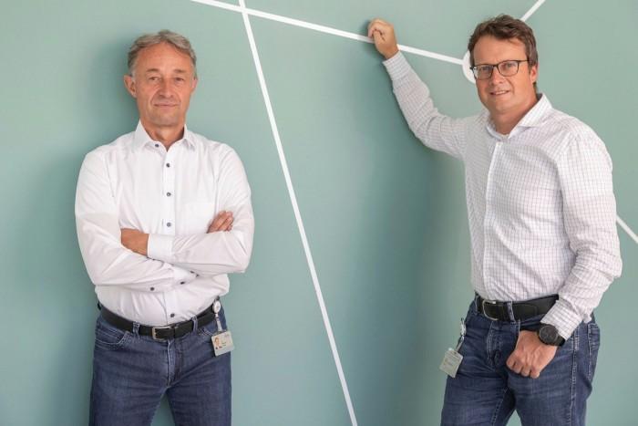 Thomas Reisinger, left, board member of Infineon Austria, with industrial engineer Andreas Wittmann