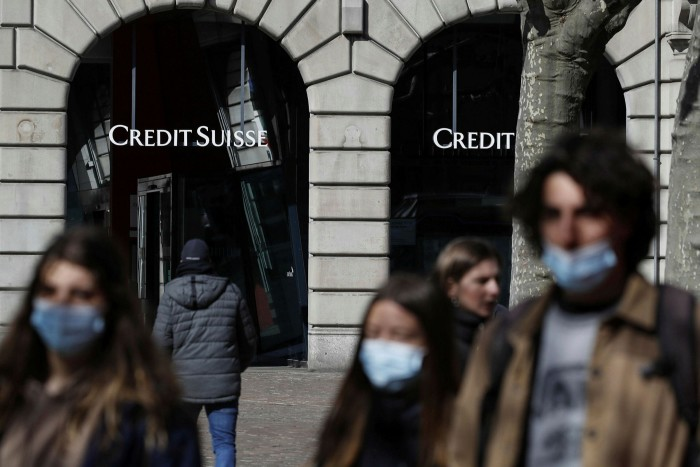 Pedestrians pass a Credit Suisse branch in Zurich. The bank was recently hit by its biggest quarterly trading loss in more than a decade — $4.7bn — linked to the collapse of family office Archegos Capital, putting its very existence in jeopardy