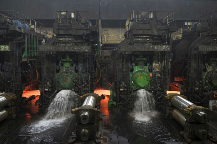 Hot rolled steel moves through a mill at the Tata Steel IJmuiden  plant in IJmuiden, the Netherlands
