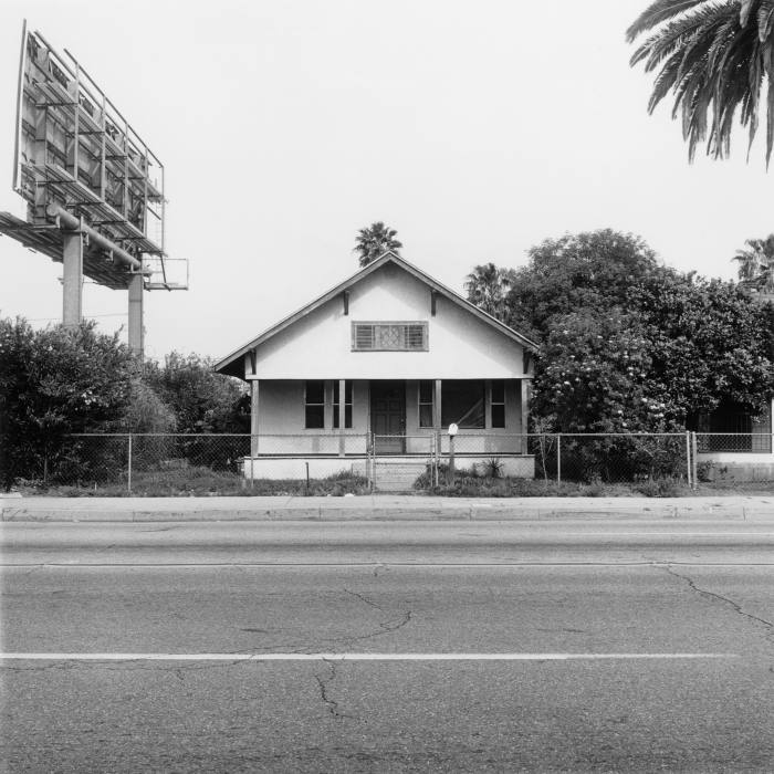 'Mile 72', 2011. This image was taken not far from the San Bernardino train station where Nigel got the right rail back home. A typical Southern California house bracketed by a billboard and a palm, complete with a citrus tree on the side.