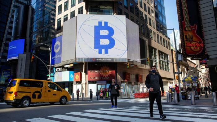 Monitors display Bitcoin signage at the Nasdaq MarketSite in New York