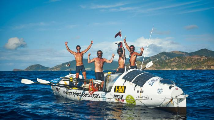 The author (far left) and hiscrewmates arriving in Antigua 48 days after setting offfrom the CanaryIslands, in2014