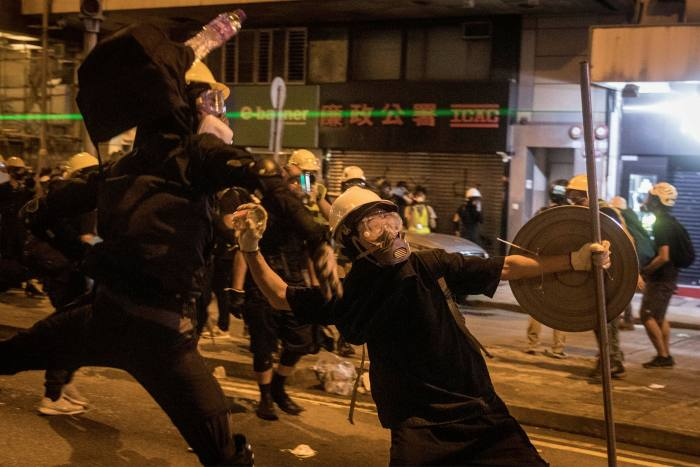 Protesters clash with police following an anti-extradition bill march last year in Hong Kong. Much is riding on how delicately Beijing exercises its power