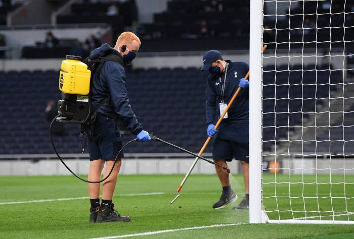 Ground staff disinfect one of the goals during the Spurs vs Man Utd game. To get on the pitch, people must adhere to a set of protocols that are far stricter than anything faced by thousands of other UK staff returning to work after lockdown
