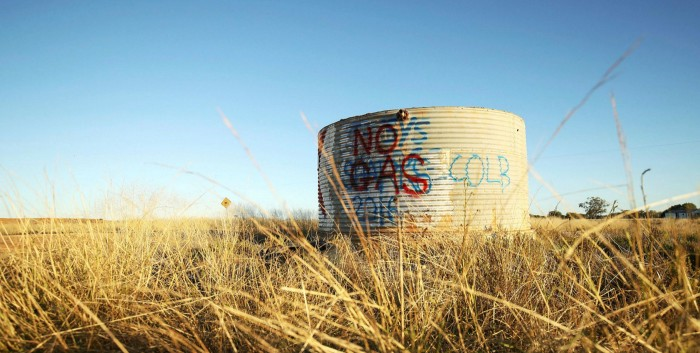 The words 'No Gas' are spray painted on the side of a tank in Narrabri, Australia. There is a renewed focus on climate change following devastating bushfires in the country