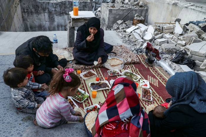 A family breaks their fast during Ramadan in the town of Ariha, southern Idlib province, earlier this month