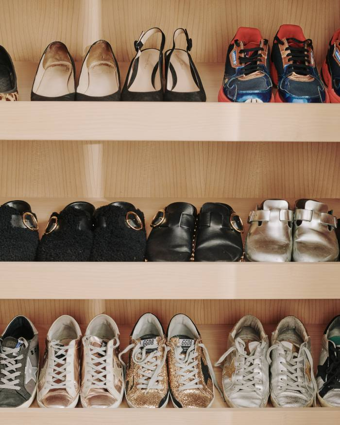 Shelves of sneakers and clogs in Dawn's dressing room