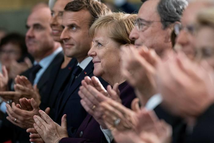 Emmanuel Macron, Angela Merkel y Mario Draghi