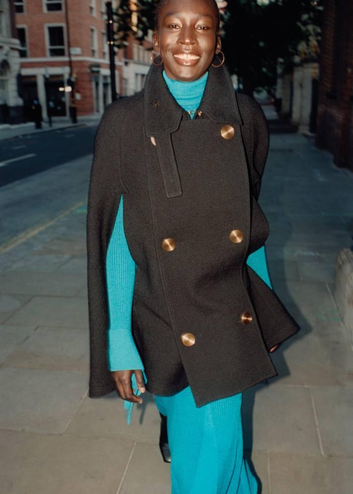 Loewe wool/cupro cape, £1,650. Carolina Herrera cotton/ silk rib tie knit rollneck, $890, and matching skirt, $790. Jimmy Choo calfskin Mahesa 85 boots (just seen) £1,175