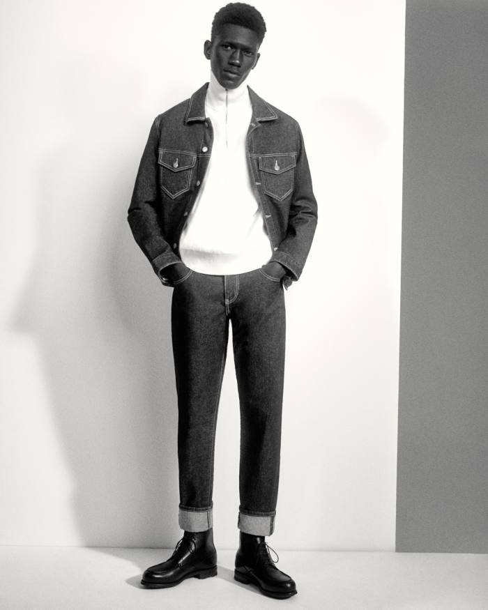 Moustapha Sy wears a Guess x Friendswithyou cotton denim jacket, £ 115, and cotton denim pants, £ 95.  Louis Vuitton cashmere turtleneck, £ 915.  JM Weston Boxcalf Golf Montant leather boots, £ 790.  Socks, specific to the model