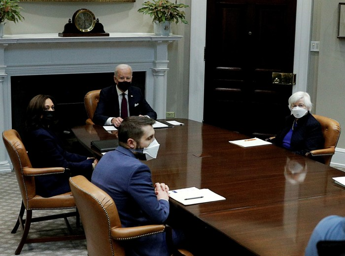 Joe Biden sits at the head of the table with Janet Yellen to his left. The US Treasury secretary said: 'I think that the passage of the American Rescue Plan will finally allow us to do what most of us came to government for... to build a better country'