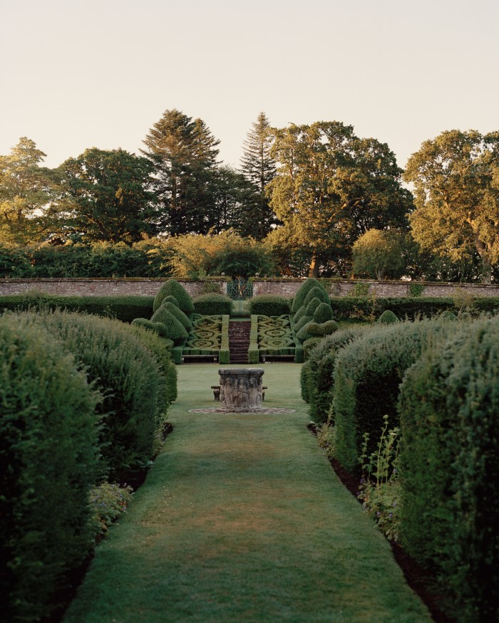 The walled garden at Airlie was built in 1790, with the yew topiary put in by the 7thCountess. Agrass tennis court now sits in one square
