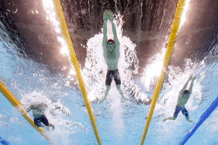 Seen from below, Peaty swims in the pool, surging ahead of Cody Miller of the US and Brazil's Felipe Silva at the Rio games in 2016