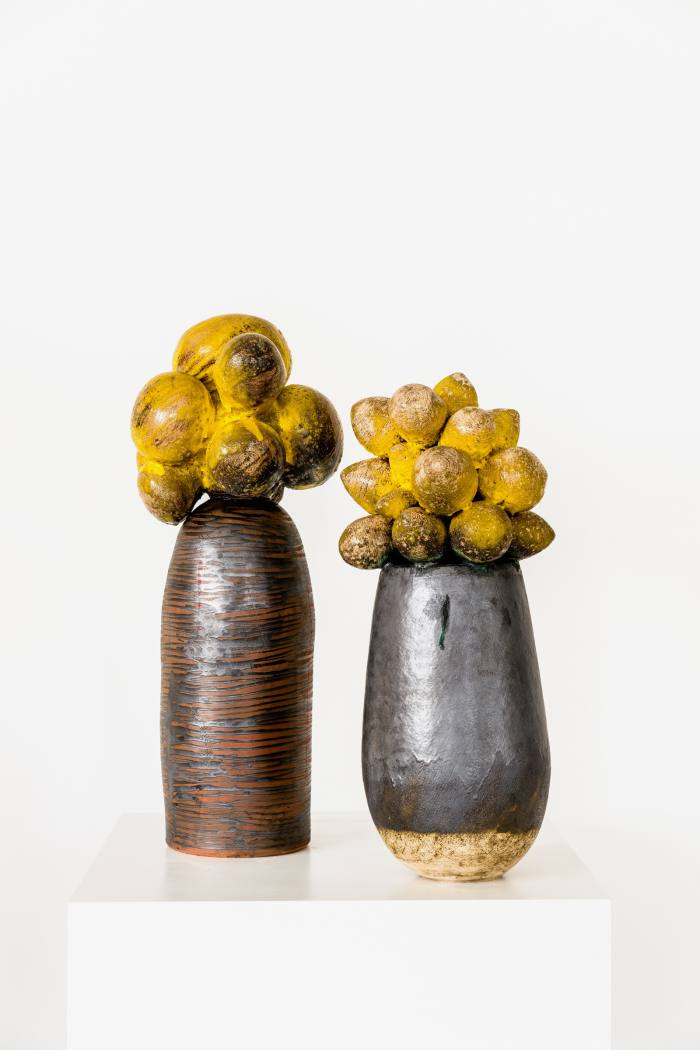 """Two of her glazed clay stoneware sculptures, """"Umthwalo – Dadobawo"""" (left) and """"Weniamo – Baobab Series"""" (right)"""