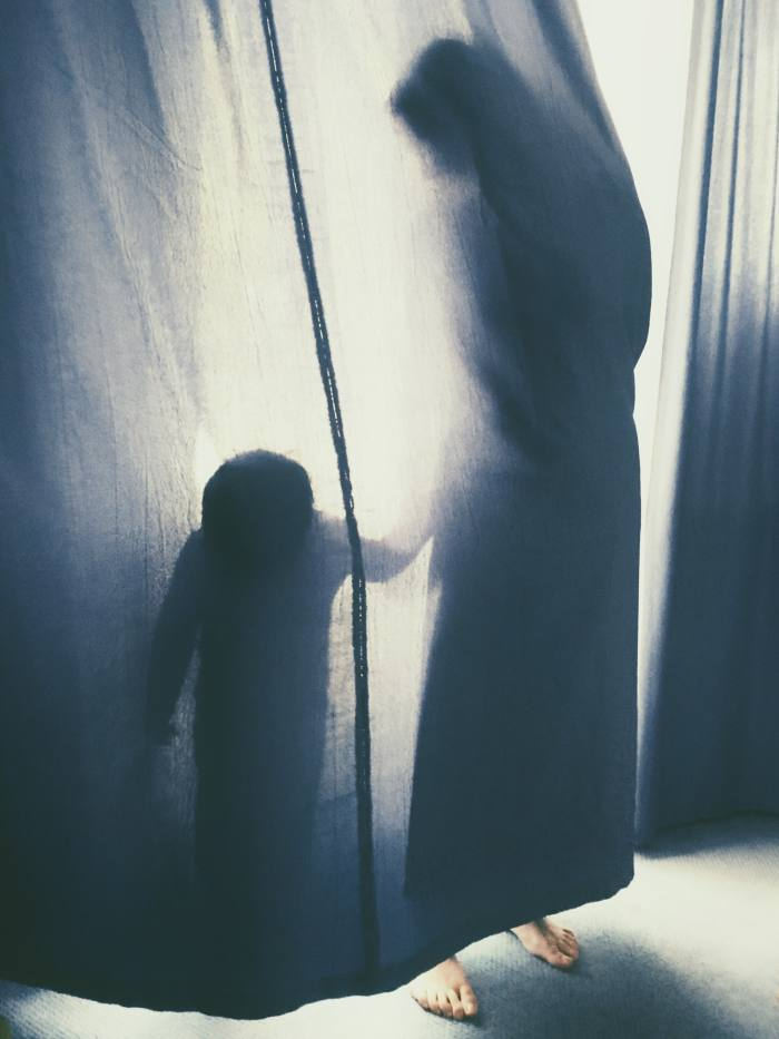 Ionut Maga's image of a mother and son embracing behind a veil