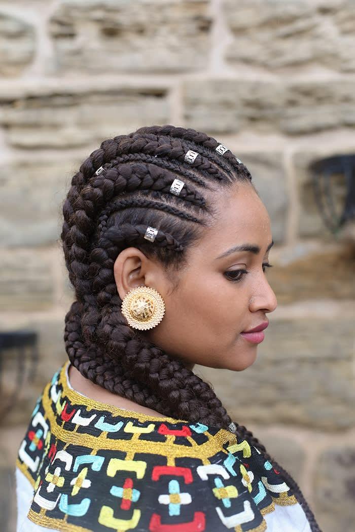 Portrait of Elsa Asmara wearing traditional Habesha kemis, her hair braided
