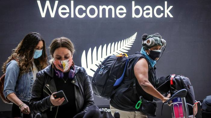 Passengers from New Zealand, one of the places where travellers are allowed to enter Australia, arrive in Sydney. Canberra has imposed some of the strictest border controls in the world due to the Covid-19 pandemic