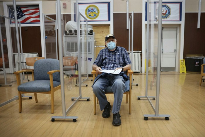 A man waits to see if he has done anything about receiving the COVID-19 vaccine and the power of the flu.