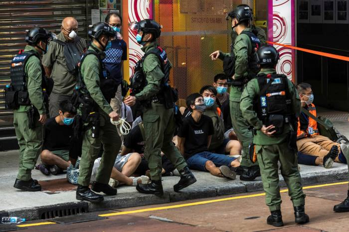 Police detain people in Hong Kong. At the G7 summit, Biden hopes to forge like-minded coalitions to rebuke China over issues such as the crackdown on the territory's pro-democracy movement