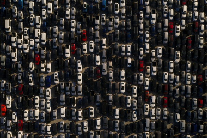 Rental cars are stored in a parking lot at Dodger Stadium in LA, California, in May 2020