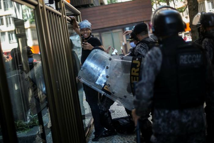 Military police disperse anti-Bolsonaro protesters in Rio de Janeiro. Critics are concerned about what the military would do if the president chose to ignore a court ruling