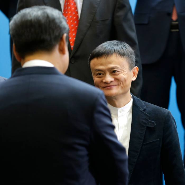 A smiling Jack Ma meeting Xi Jinping during a visit to Microsoft in Washington, in 2015