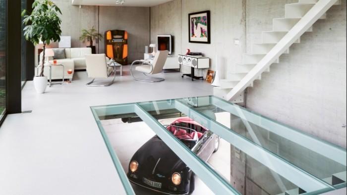 A replica Porsche 356 Speedster seen through a glass floor
