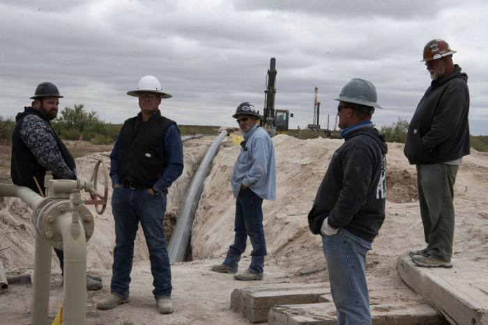 Workers lay a pipeline in Lea County, New Mexico, last September