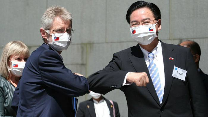 Milos Vystrcil is greeted by Taiwanese foreign minister Joseph Wu. China said the Czech senator's arrival in Taiwan 'crossed a red line' for which there would be a 'heavy price'