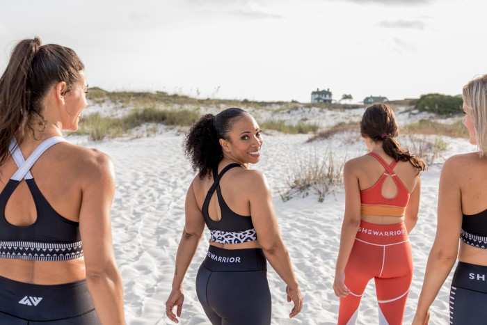 Natlyn Jones (centre) created SheWarrior in 2019 to combine style and sustainability in sportswear