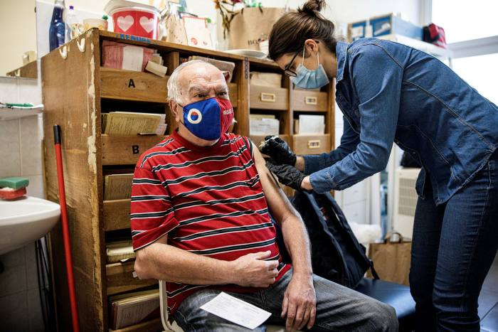 Medical worker administers a jab in Hungary