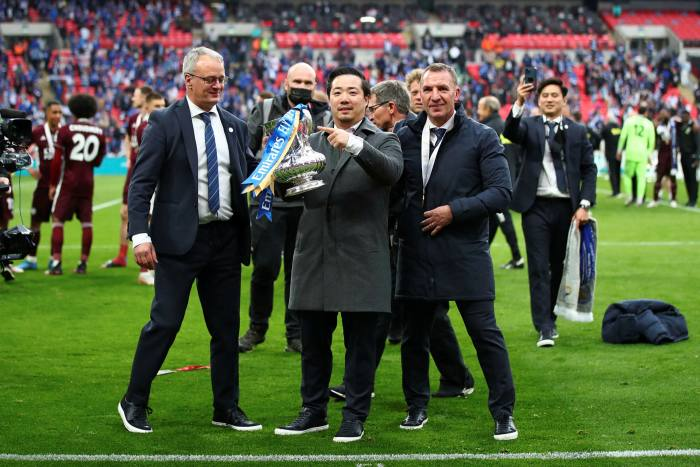 Leicester City's Jon Rudkin, Khun Top and Brendan Rodgers celebrate the team's FA Cup victory in May against Chelsea