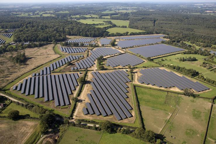 Aerial Views Of The Primrose Solar Ltd Southwick PV Solar Plant...Solar panels sit in an array at the Southwick Estate Solar Farm, operated by Primrose Solar Ltd., near Fareham, U.K., on Friday, Oct. 2, 2015. The plant, situated in 200 acres (81 hectares) of farmland, consists of 175,000 monocrystalline PV modules and has a capacity of 48 megawatts. Photographer: Simon Dawson/Bloomberg