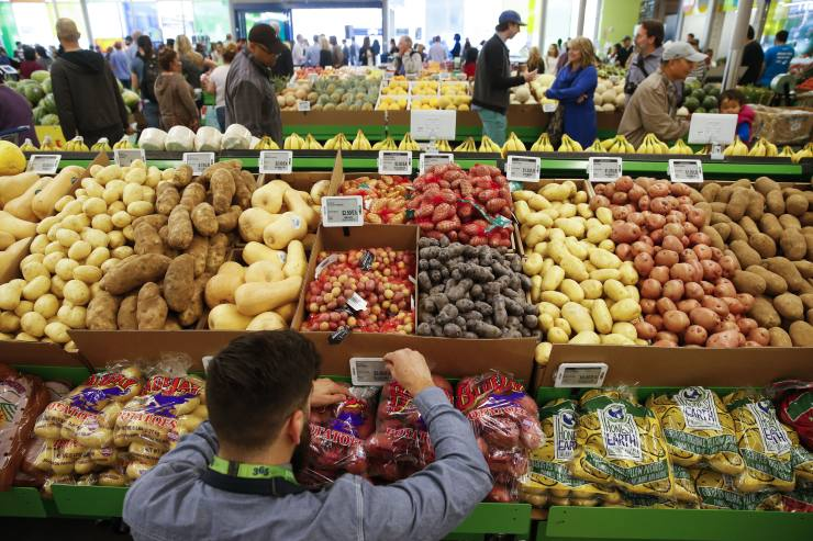 An employee arranges a digital price tag for vegetables on the opening day of the 365 by Whole Foods Market store in the Silver Lake neighborhood of Los Angeles, California, U.S., on Wednesday, May 25, 2016. Whole Foods Market Inc., plans to open 10 of the grocery stores in 2017 with a focus on everyday low prices and convenience. Photographer: Patrick T. Fallon/Bloomberg