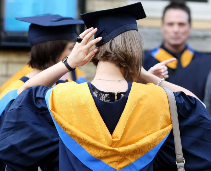 Embargoed to 0001 Sunday December 10 							 							File photo dated 12/10/11 of university graduates. Universities offering shorter degrees will be able to charge up to £11,100 a year for the courses under Government plans, but students will be left with a smaller overall bill. PRESS ASSOCIATION Photo. Issue date: Sunday December 10, 2017. See PA story EDUCATION Degrees. Photo credit should read: Chris Radburn/PA Wire